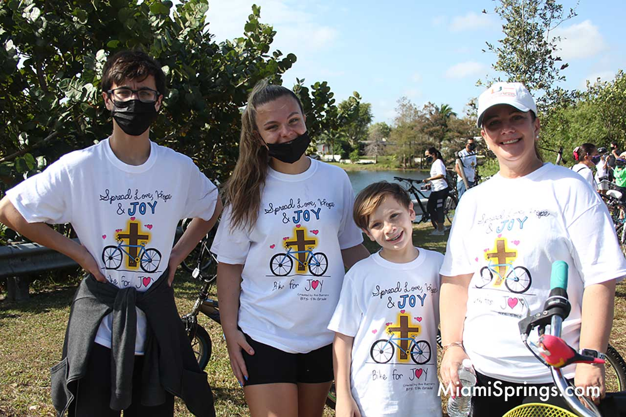 Suarez family enjoying the Blessed Trinity Bike Ride through Miami Springs