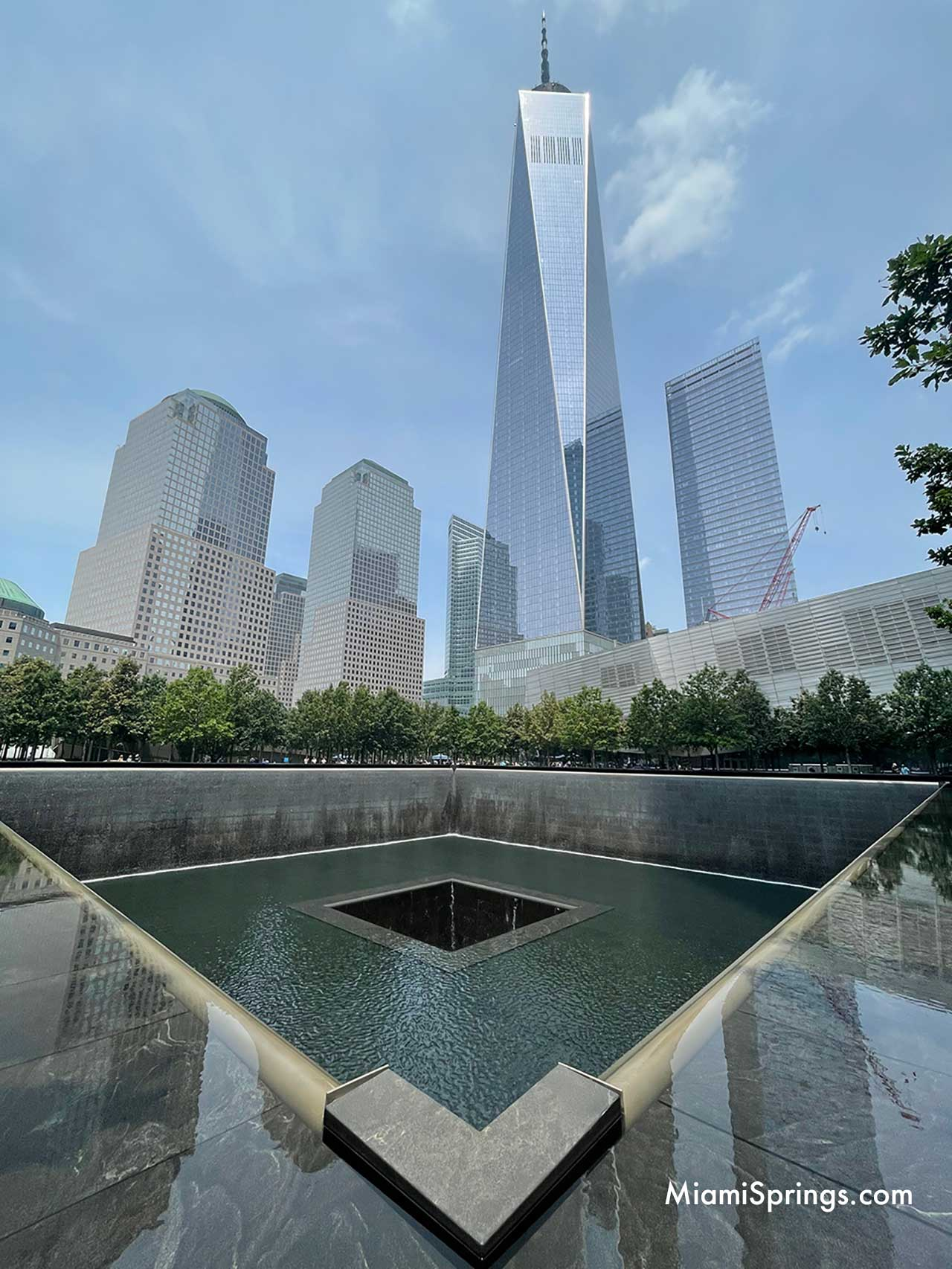 Freedom Tower and Reflection Pond at September 11 Memorial in New York City