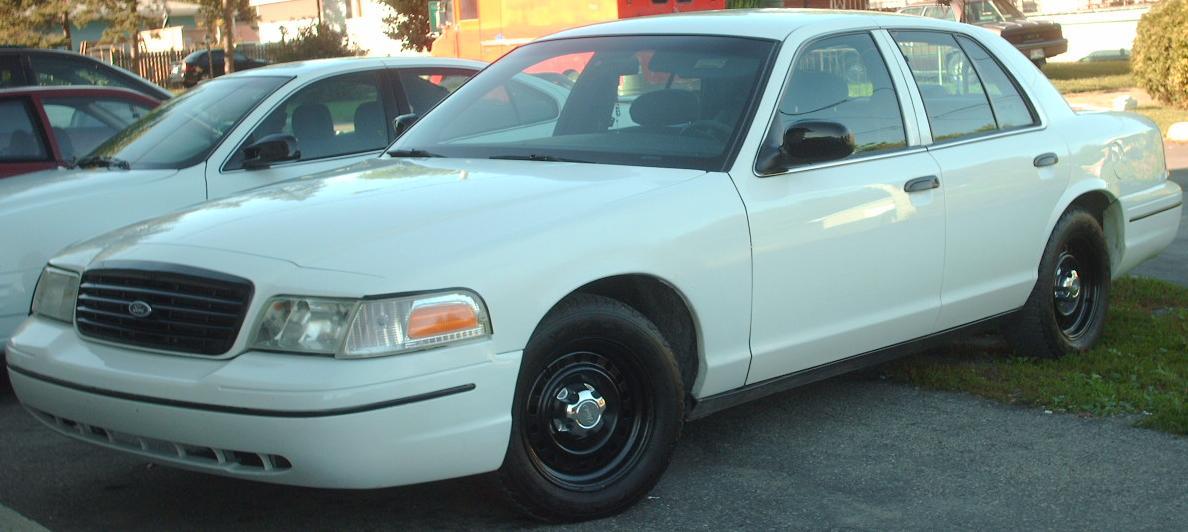 White Ford Crown Victoria